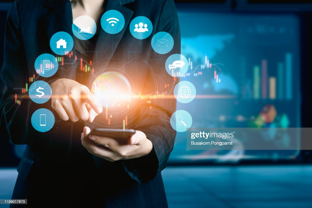 Businesswomen using mobile phone analyzing data and economic growth graph chart. Technology digital marketing and network connection. : Photo