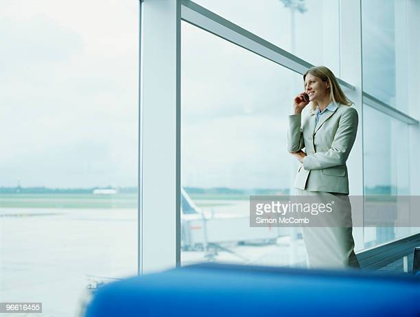 businesswomen using mobile - stansted airport stock pictures, royalty-free photos & images