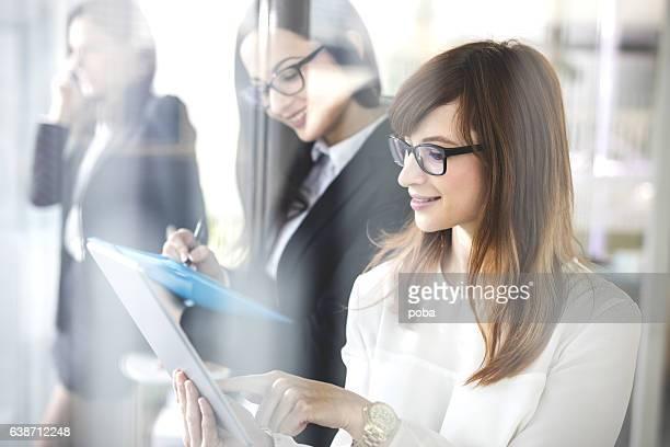 Businesswomen using technology in  office