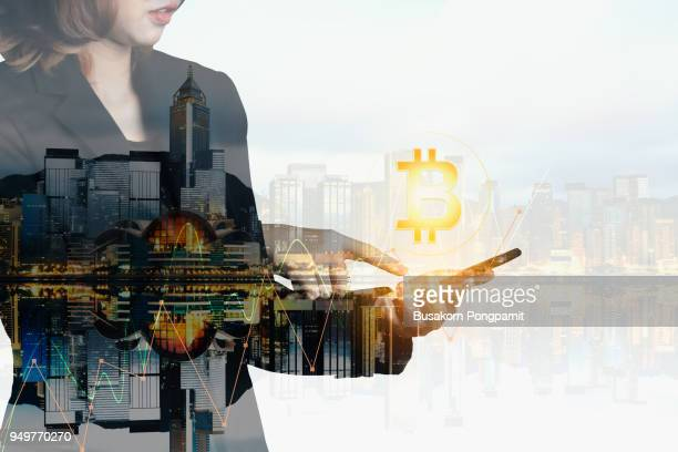 Businesswomen using the mobile phone deal bitcoin trading exchange stock market investment, forex with trend of graph technology concept