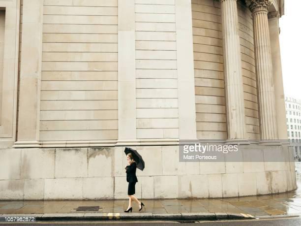 Businesswomen walking along pavement