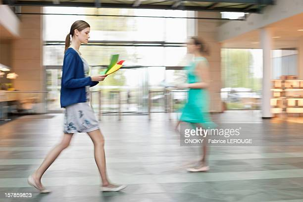 Businesswomen walking in an office lobby