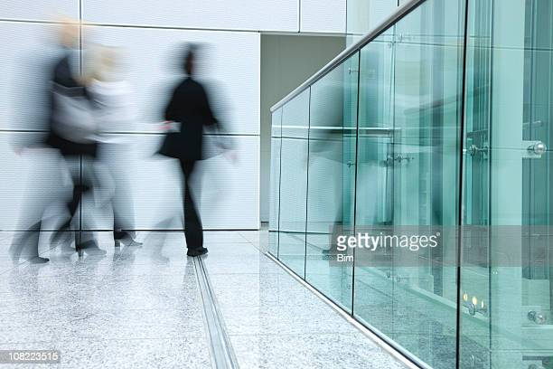 Businesswomen Walking in Modern Office Building