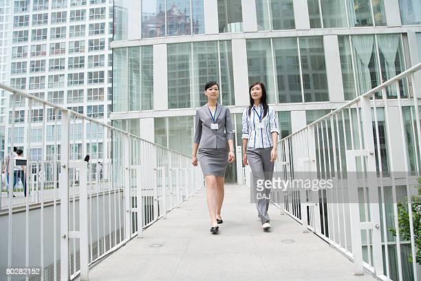 Businesswomen Walking through Corridor, China, Beijing