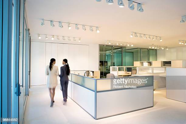 Businesswomen walking together in office