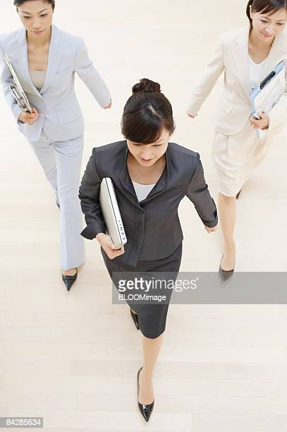 Businesswomen walking, view from above