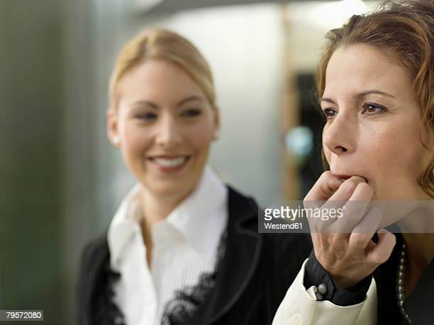 Businesswomen whistling on fingers