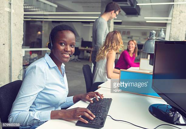 Businesswomen working at call center.