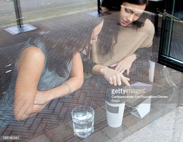 Businesswomen working in cafe with digital tablet
