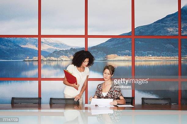 Businesswomen Working in Conference Room