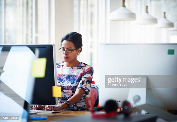 businesswomen working in modern office - typing stock pictures, royalty-free photos & images