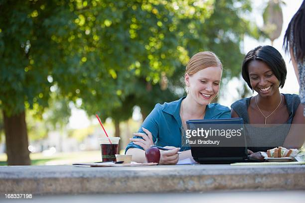 businesswomen working in park - lunch break stock photos and pictures
