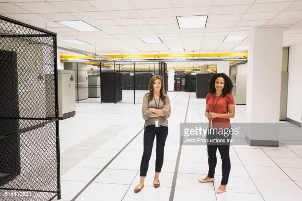 Businesswomen working in server room