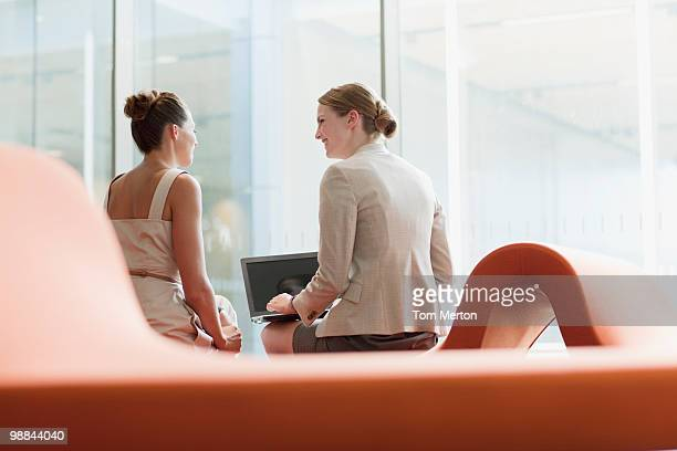 Businesswomen working in waiting area