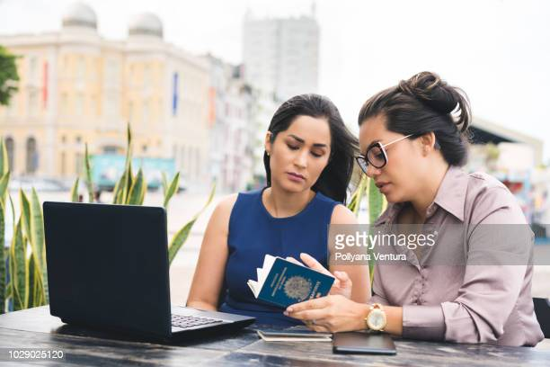 businesswomen working outdoors - register stock photos and pictures