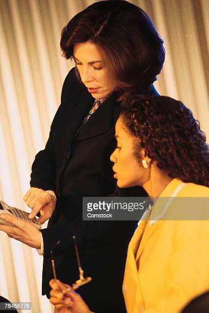Businesswomen working with calculator