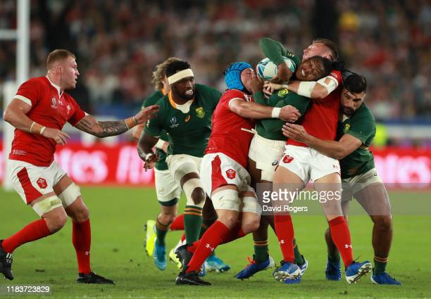 S'busiso Nkosi of South Africa is tacked by Justin Tipuric and Dan Biggar of Wales during the Rugby World Cup 2019 SemiFinal match between Wales and...