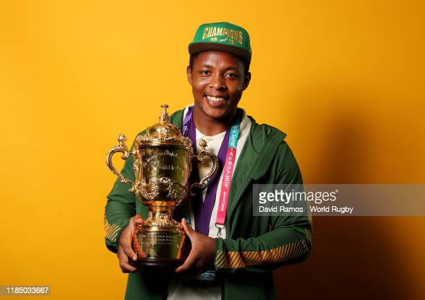 Busiso Nkosi of South Africa poses for a portrait with the Web Ellis Cup following his team's victory against England in the Rugby World Cup 2019...
