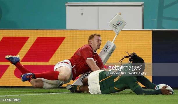Busiso Nkosi of South Africa scores his team's second try past Peter Nelson of Canada during the Rugby World Cup 2019 Group B game between South...