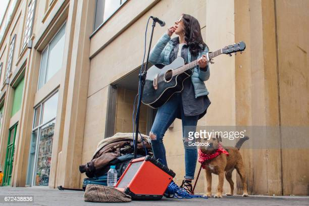 Busker And Her Dog