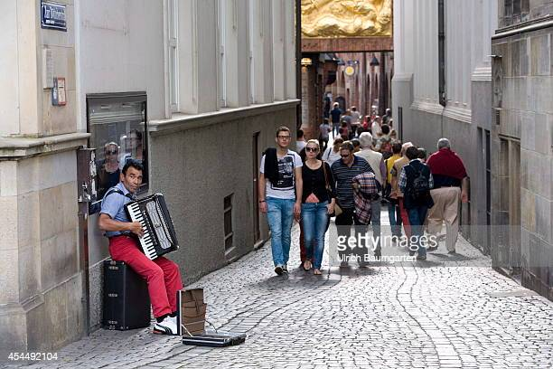 Busker and tourists in the Boettcher street in the downtown area of the Free Hanseatic City of Bremen on August 28 2014 in Bremen Germany