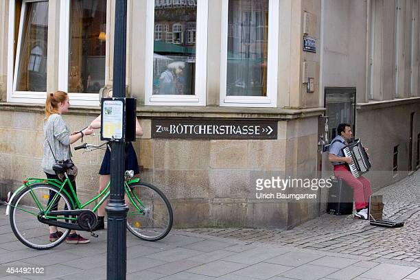 Busker in the Boettcher street in the downtown area of the Free Hanseatic City of Bremen on August 28 2014 in Bremen Germany