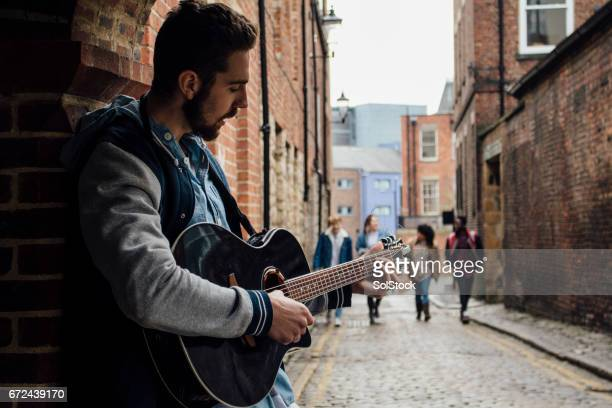 busker in the street - busker stock pictures, royalty-free photos & images