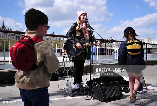 A busker performs on the Southbank in central London on April 14 2014 Concerned that London's seasoned street musicians are being silenced by...