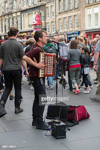 Busker playing on the Royal Mile in Edinburgh