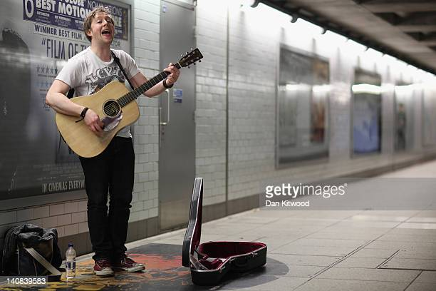 A busker plays at an Underground station on February 28 2012 in London England London's underground rail system commonly called the tube is the...
