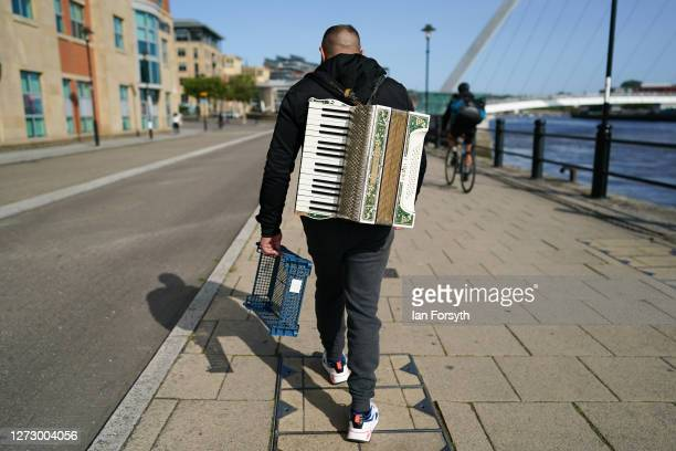 A busker walks along Newcastle quayside on September 17 2020 in Newcastle upon Tyne England Almost two million people in northeast England will be...