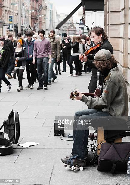 buskers performing in glasgow city centre - theasis stock pictures, royalty-free photos & images