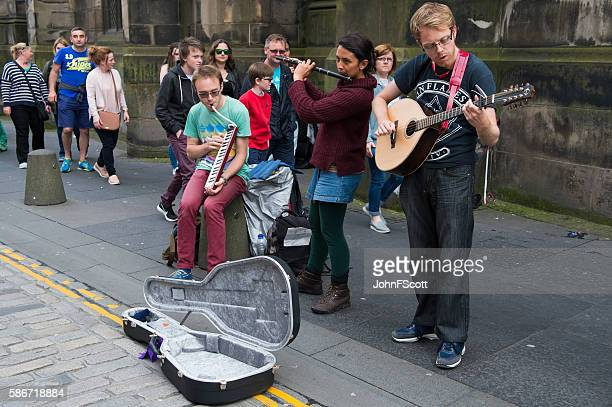 Buskers playing on the Royal Mile in Edinburgh