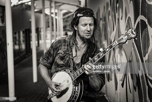 CONTENT] A buskers sings and plays his banjo for the shoppers at the Ainslie shops Canberra