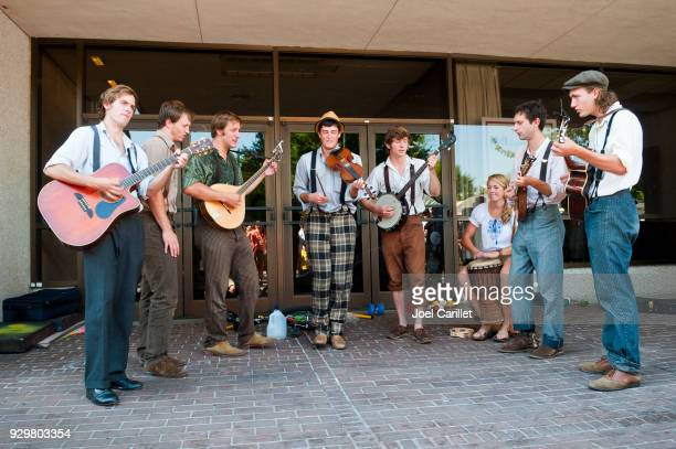 busking at asheville's bele chere festival - asheville stock pictures, royalty-free photos & images