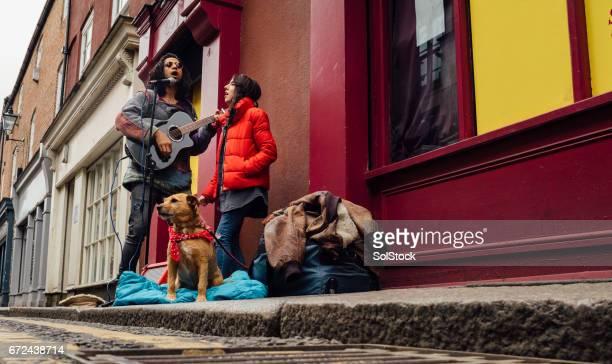 Busking Couple With Dog
