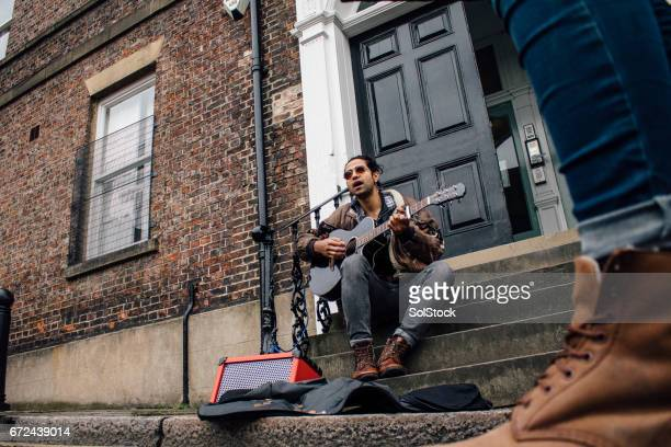 busking in the city - busker stock pictures, royalty-free photos & images