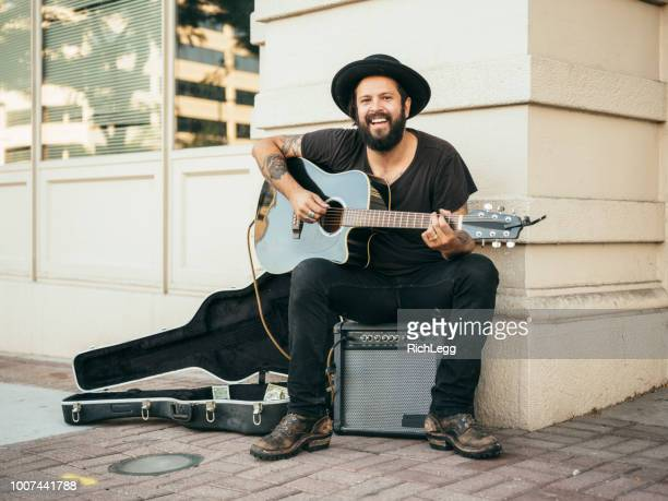 busking street musician - street artist stock pictures, royalty-free photos & images
