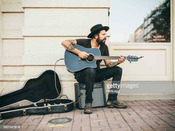 busking street musician - busker stock pictures, royalty-free photos & images