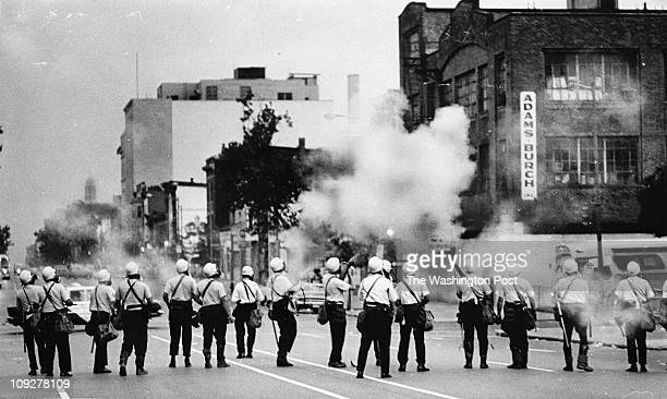 APRIL 1968 A busload of Civil Disturbance Unit police sweeps 14th Street and saturates the area with tear gas PHOTO by FRANK HOY / TWP1968 riots...