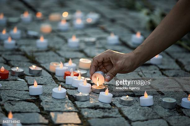 Busra Kayi Tarhan from Istanbul lights a candle in Dupont Circle during a vigil for the victims of the Istanbul Airport terrorist attack Washington...