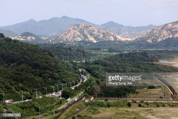Busses carrying South Koreans chosen to attend a family reunion event with their North Korean relatives move to North Korea in the Demilitarized Zone...