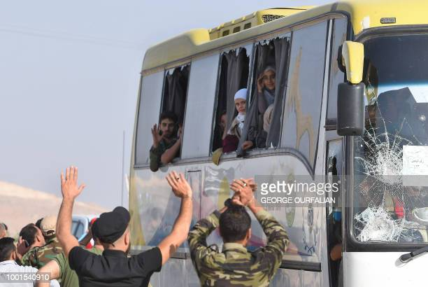 Busses transporting residents and fighters from the towns of Fuaa and Kefraya arrive in the Syrian regimeheld territory of the alEis crossing point...