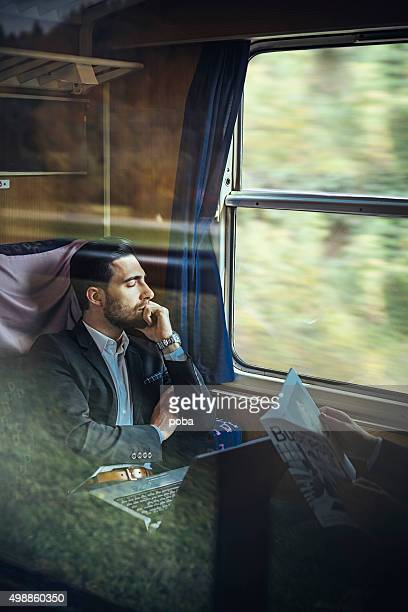 bussinesman  relaxing on the passenger train - next to stock pictures, royalty-free photos & images