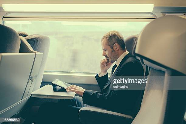 Bussinesman traveling on a train