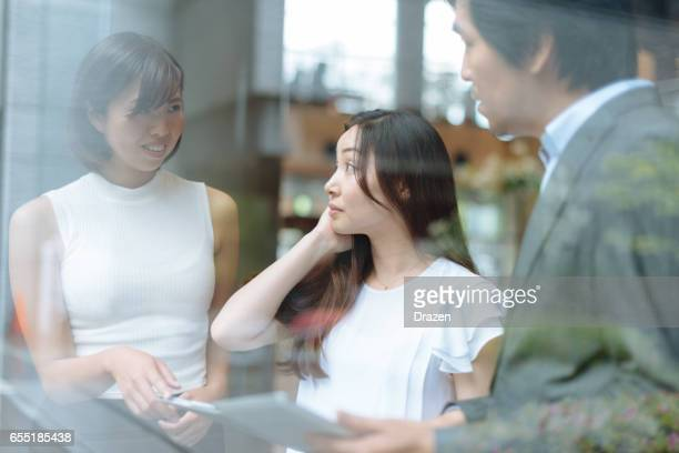 Bussiness in Japan - Group of Japanese male and female business people in corporate building