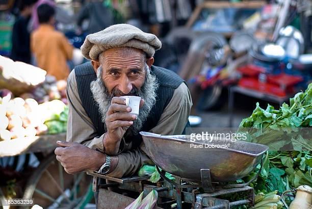 Bussinessman drinks tea during short break in Gilgit bazaar, Karakoram, north Pakistan.