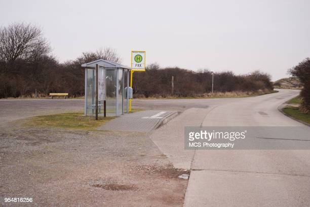 busstop at nudist beach of northsea island borkum - skinny dipping stock photos and pictures