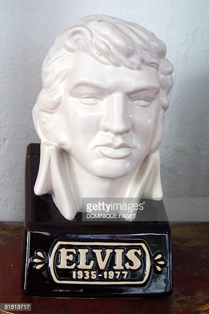 A bust dated 1988 of Elvis Presley is displayed at the International Museum of Modest Arts of Sete southern France 30 August 2001 during the...