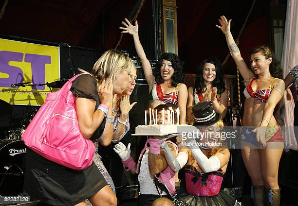Bust EditorinChief/Publisher Debbie Stoller and Creative Director/Publisher Laurie Henzel blow Birthday candles out at the Bust Magazine's 15th...